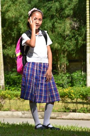 Bashful Female Student With Notebooks Stock Photo