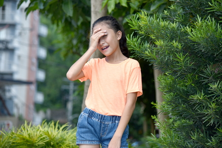 Young Girl And Shyness Stock Photo