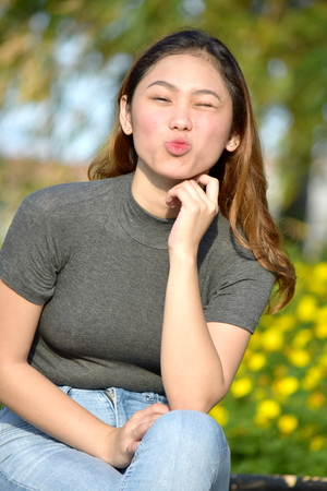 A Youthful Female Kissing Stock Photo