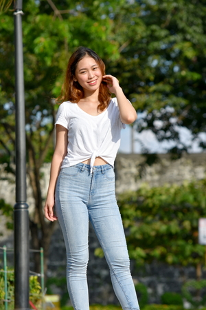 Youthful Asian Female Standing