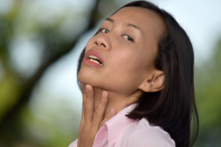 Young Female With Sore Throat Banco de Imagens