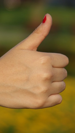 Female Hand Thumbs Up