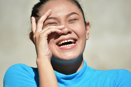 An Asian Female Laughing