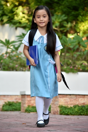 A Female Student Walking