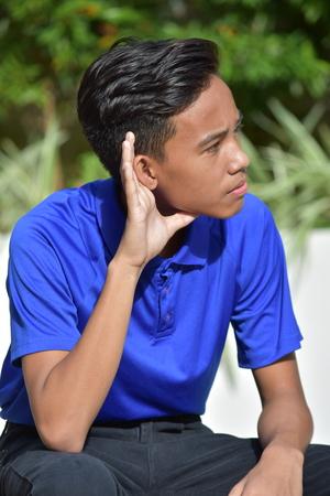 An Asian Youth Hearing Banco de Imagens