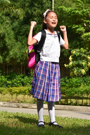 Proud Filipina Person With Notebooks 스톡 콘텐츠