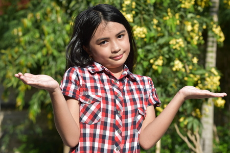 Undecided Youthful Filipina Girl Preteen