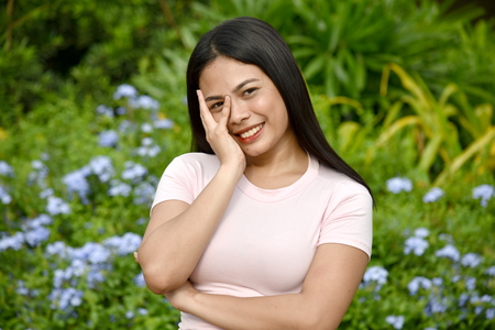 Shy Youthful Filipina Woman Stock Photo
