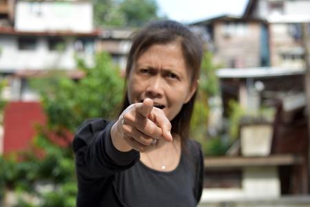 A Female Senior Pointing