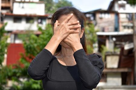 Ashamed Asian Female Senior Gramma Stock Photo
