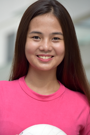 Filipina Female Volleyball Player And Happiness With Volleyball Stock Photo