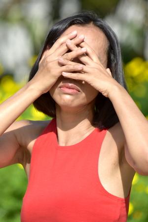 An Ashamed Female Woman Stock Photo