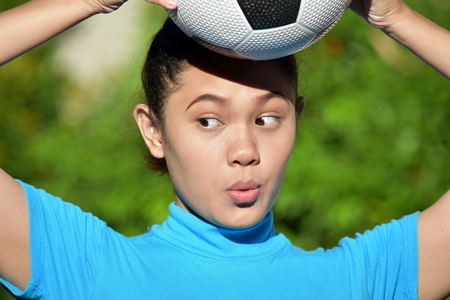 Surprised Filipina Person With Soccer Ball