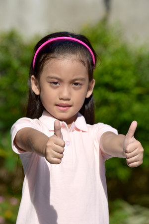 Filipina Female With Thumbs Up Stock Photo