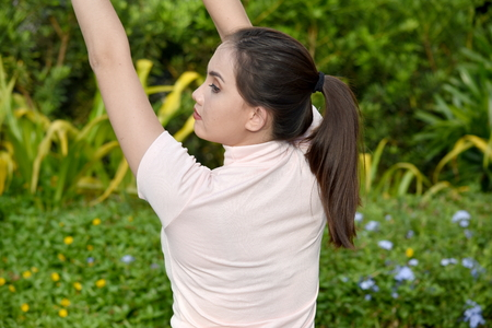 A Stretching Asian Female
