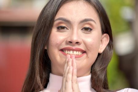 A Pretty Woman Praying Stock Photo