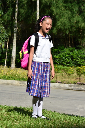 Filipina Female Student Winking Wearing Uniform Stock Photo