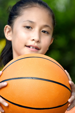Happy Diverse Female Athlete With Basketball 스톡 콘텐츠