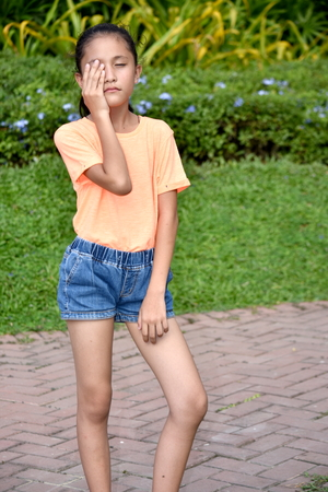 Ashamed Cute Female Youngster Stock Photo - 121476968