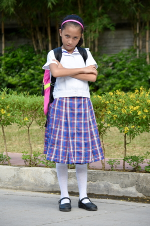 Stubborn Girl Student Wearing School Uniform With Notebooks