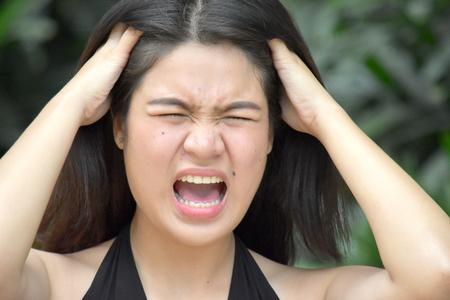 Anxious Beautiful Filipina Person Stock Photo
