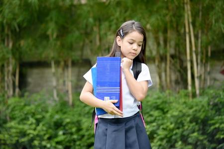 Filipina School Girl Decision Making Wearing School Uniform