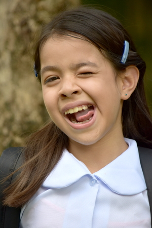 Young Minority School Girl Making Funny Faces