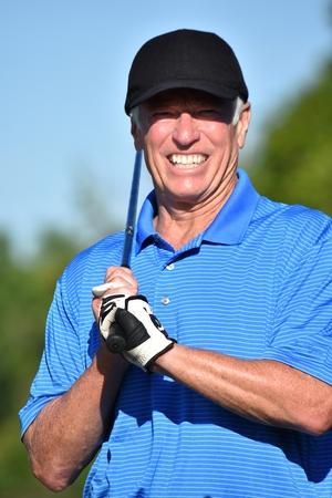 Smiling Retiree Male Golfer With Golf Club Golfing
