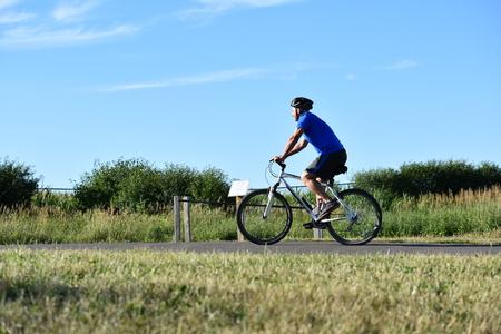 Retiree Male Cyclist Working Out Wearing Helmet Biking Stock Photo