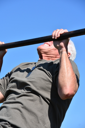 Veteran And Muscles Exercising Stock Photo