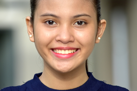 A Smiling Young Female