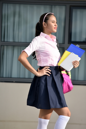 Diverse School Girl Student Teenager Posing With Notebooks