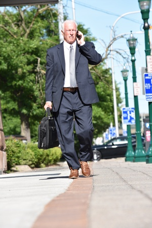 Unemotional Adult Senior Person Wearing Suit And Tie Walking