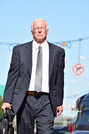 Unemotional Business Man Investor Wearing Business Suit Walking