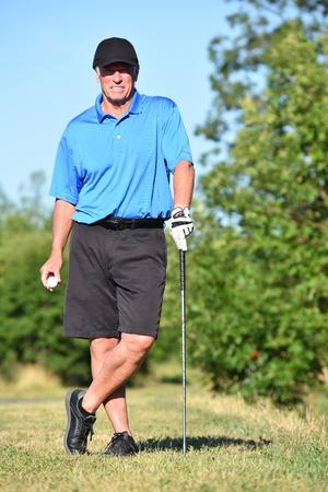 Athlete Retiree Male Golfer Posing With Golf Club Zdjęcie Seryjne