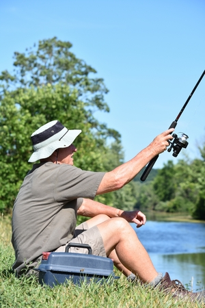 With Fishing Rod Outdoors
