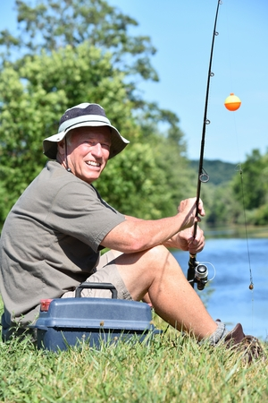 Male Fisherman And Happiness With Fishing Rod Fishing