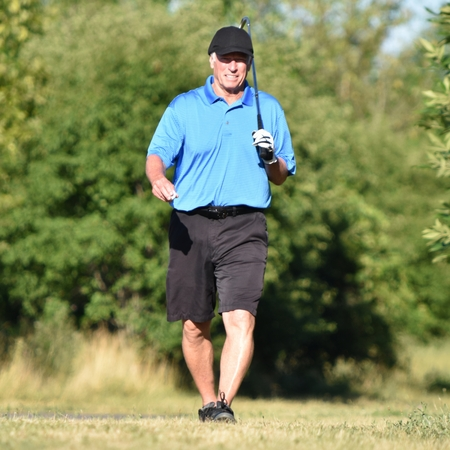 Unemotional Older Retiree Person With Golf Club On Golf Course Stockfoto