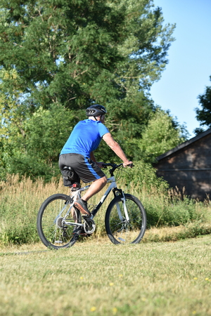 Male Cyclist Exercising Riding Bike