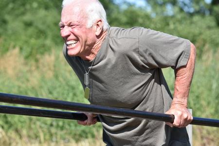 Stressful Male Veteran Exercising 免版税图像
