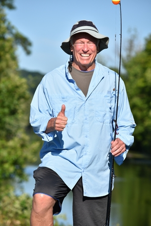 Outdoorsman With Thumbs Up With Fishing Rod Fishing