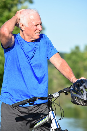 Adult Male Athlete Resting Wearing Helmet Riding Bike