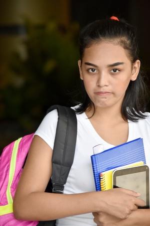 Unhappy Cute Minority School Girl