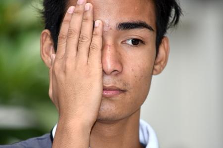 Shameful Handsome Minority Person Stock Photo