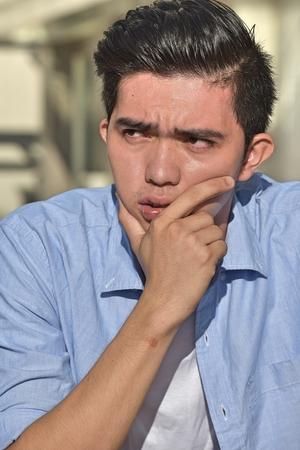 Young Male Making A Decision Banco de Imagens - 122092989
