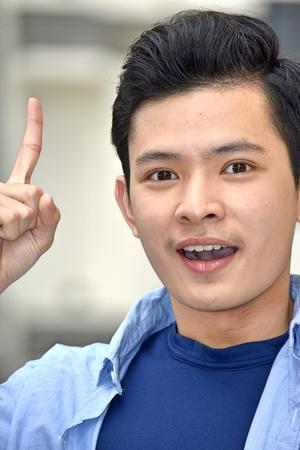 Chinese Teen Boy Having An Idea Фото со стока
