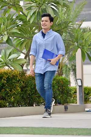 Intelligent Handsome Minority Boy Student Walking On Campus 写真素材