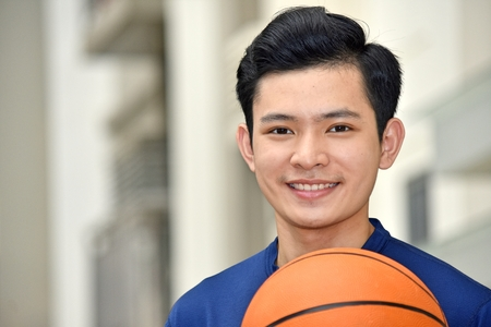 Diverse Male Basketball Player Smiling 스톡 콘텐츠