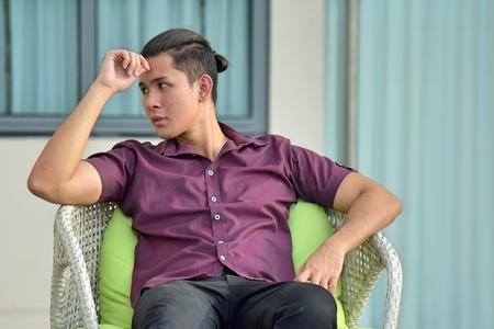 Handsome Asian Man Thinking At Condo