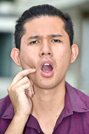 Young Male With Toothache Stockfoto